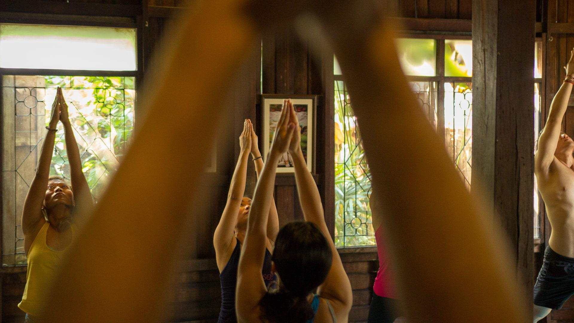 Morning yoga class at Wild Rose Yoga Studio Chiang Mai Thailand Old City.