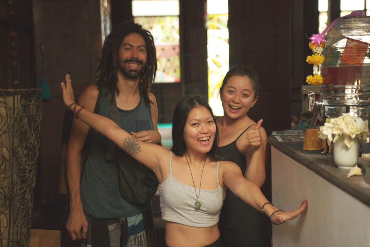 Yoga students hanging out after a yoga class at Wild Rose Yoga Studio Old City Chiang Mai Thailand.